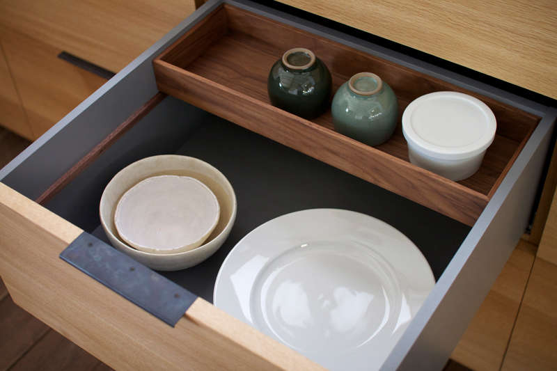 A sliding wood box maximizes drawer storage space. (For more of these kinds of ingenious storage solutions, see  Storage Ideas to Steal from High-End Kitchen Systems.)