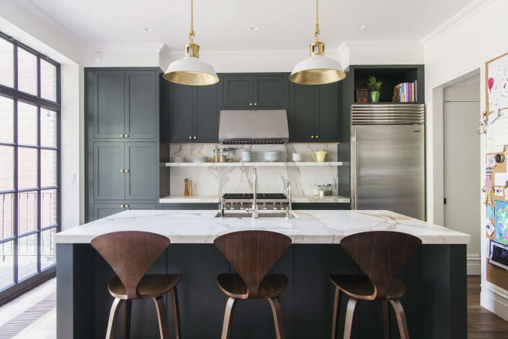Trend Alert 10 Favorite TimeTested Dark Green Kitchens In a Brooklyn townhouse gutted and remodeled by architect Elizabeth Roberts for a young family, the kitchen is the star. Countertops are Calacatta Gold marble and cabinets are color matched to a Waterworks hue called Wellie. See more inAn Unfussy Brooklyn Townhouse Remodel from Architect Elizabeth Roberts. Photograph by Dustin Aksland, courtesy of Elizabeth Roberts.