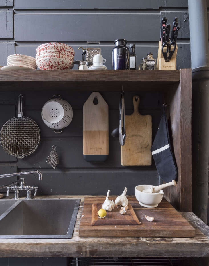 Cooking essentials hang from an exterior wall in a courtyard kitchen at March in San Francisco. Photograph by Matthew Williams for Gardenista. SeeSteal This Look: The Deconstructed Outdoor Kitchenon Gardenista.