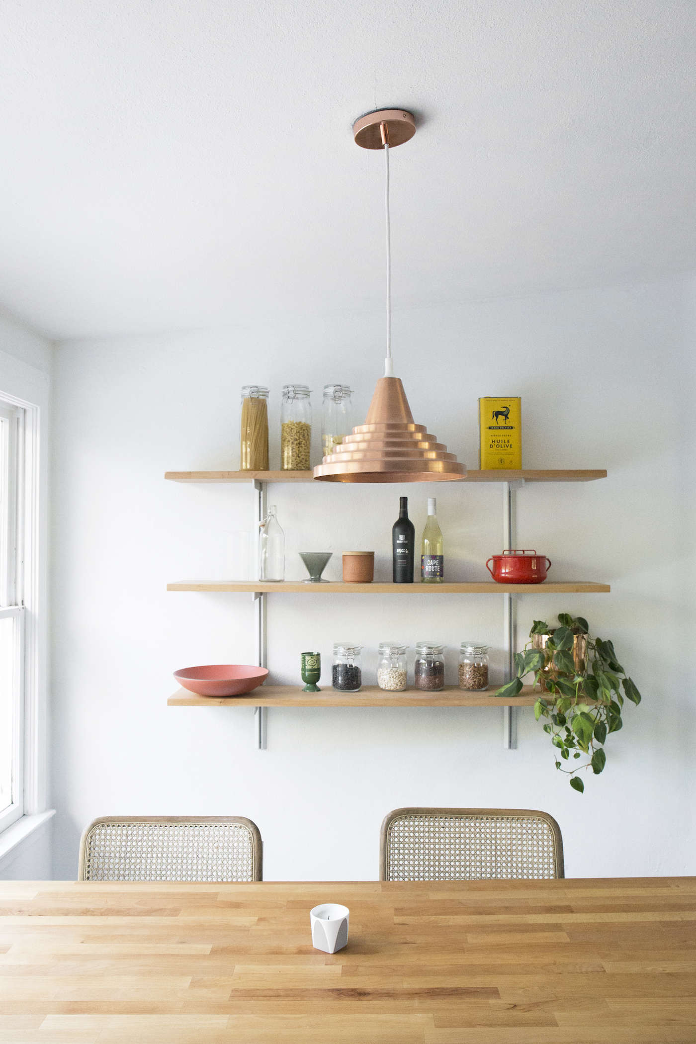 midcentury-budget-remodel-copper-pendant-light-over-dining-table