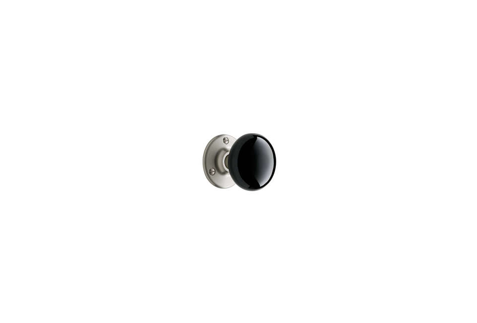 The Tate Black Porcelain Interior Knob can be customized with a base in brushed or polished nickel (shown), burnished antique, lacquered or unlacquered brass, chrome, and oil-rubbed bronze; $9 at Rejuvenation.