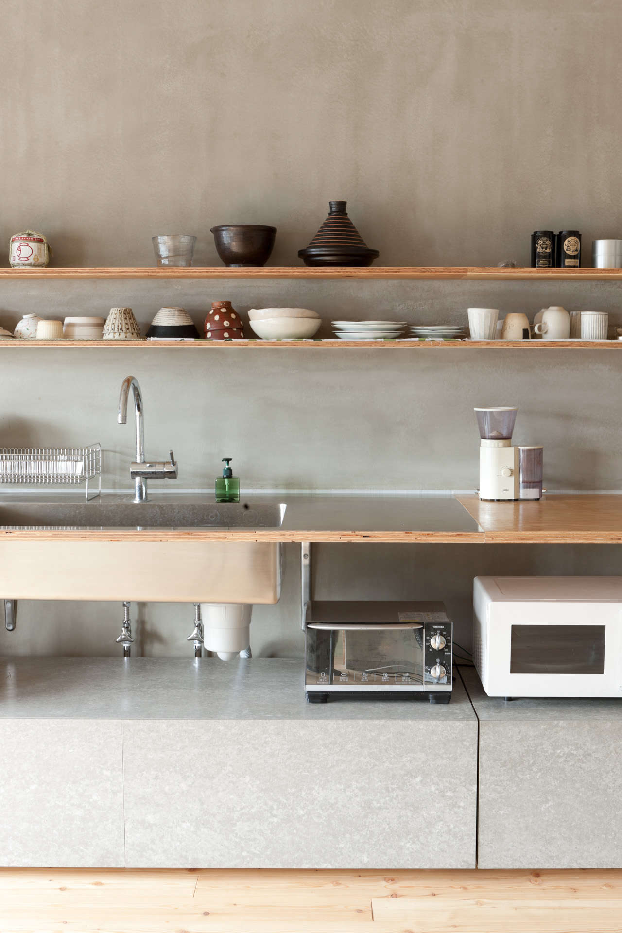 A kitchen in Japan with a mix of concrete and wood by Naruse Inokuma Architects fromSteal This Look: A Restaurant Supply Kitchen in Tokyo.