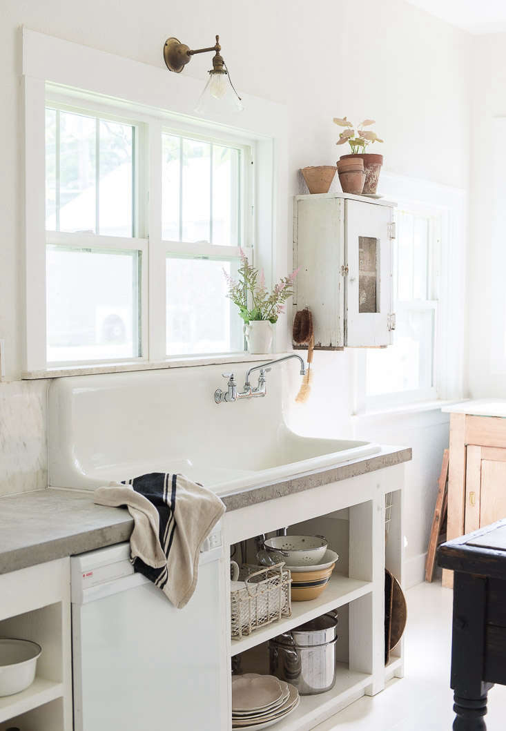 A white-fronted dishwasher is unobtrusive with the neutral palette ofKitchen of the Week: In Montana, Rustic Chic on a Budget.