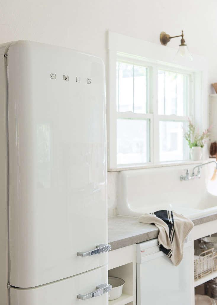 vintage whites blog kitchen remodel smeg fridge concrete countertops 15
