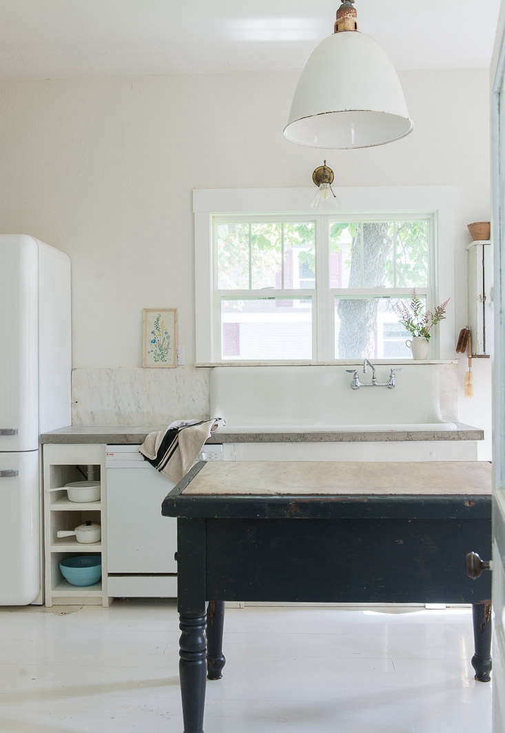 A white Smeg, chosen for its narrow width, inKitchen of the Week: In Montana, Rustic Chic on a Budget.