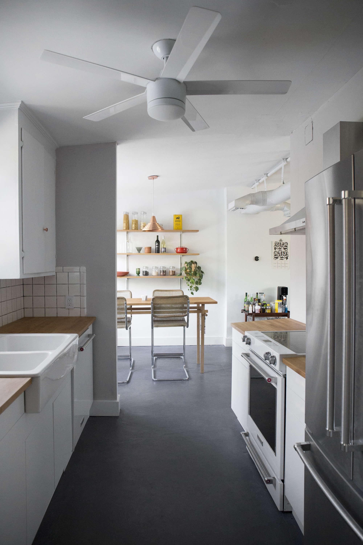 white-budget-kitchen-remodel-ceiling-fan-concrete-floors