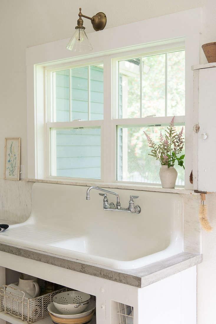 white farmhouse sink concrete countertops budget kitchen remodel 18