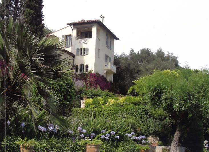 A glimpse of the stucco house, fronted by a tower that overlooks the Mediterranean.