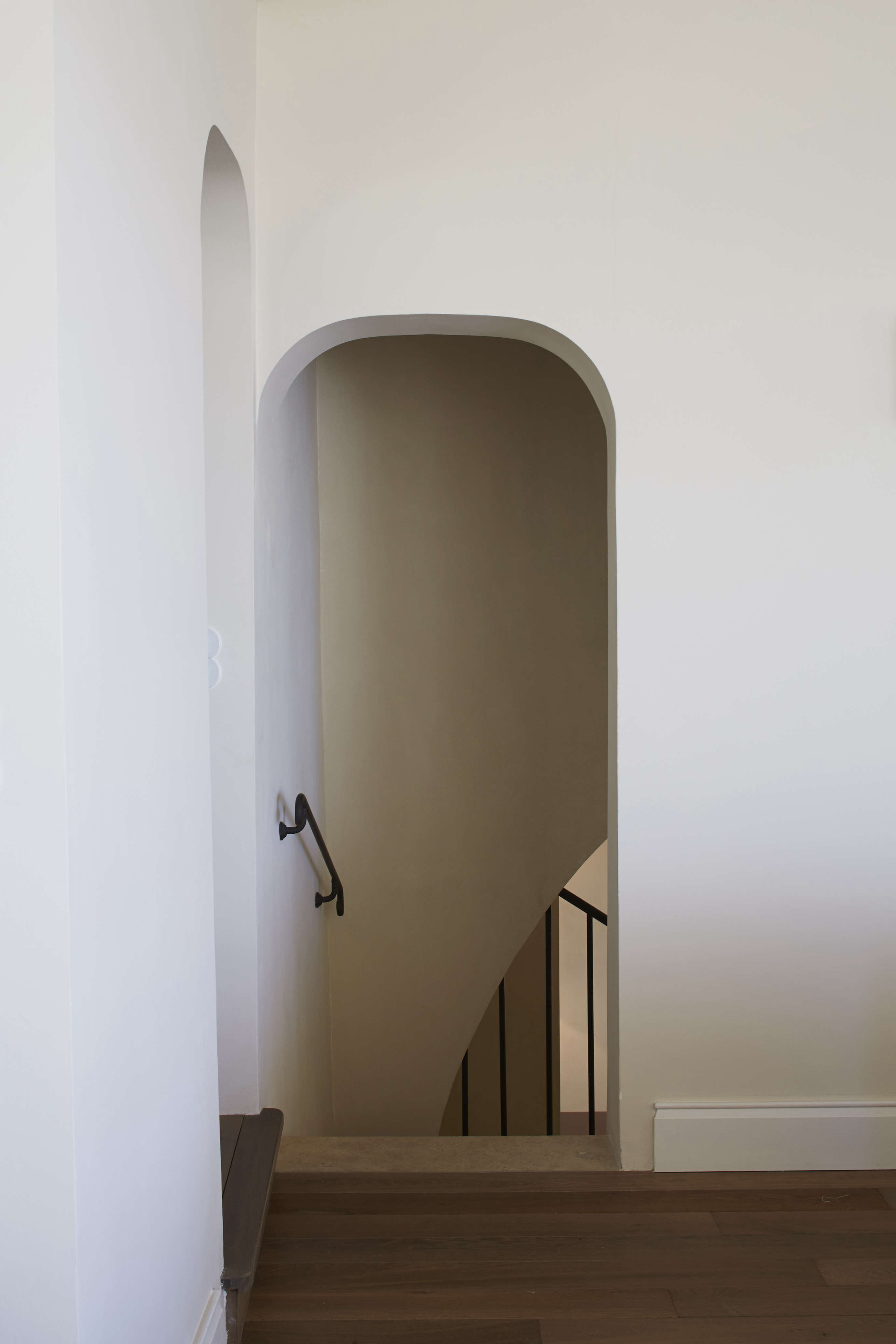 The lines of the arched doorways and stair walls are highlighted by the lime plaster, which adds nuance and depth to the walls. Read about a DIY version in our posts Limewashed Walls for Modern Times and Build-It-for-Less Materials.