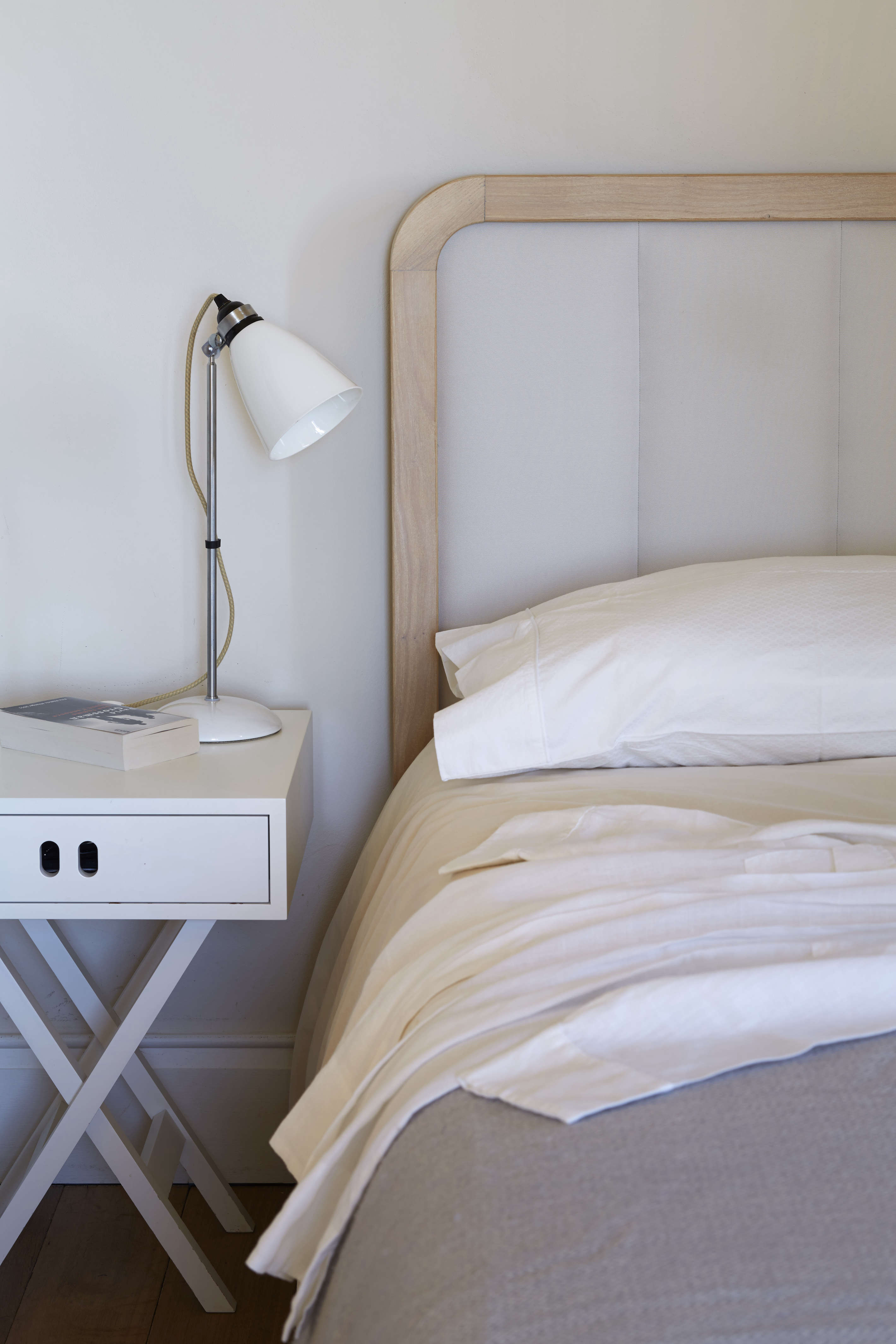 On the bedside tables, we were happy to spot a Remodelista favorite, the BTC Hector Medium Dome Table Lamp with a bone-china shade. (See the Remodelista book, page 7, and High/Low: The Classic English Table Lamp from Original BTC.)