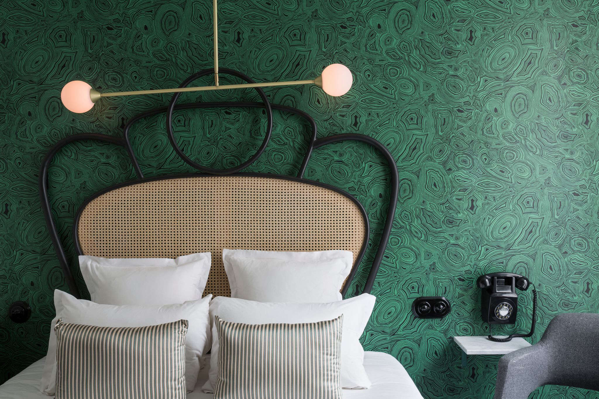 The Malachite wallpaper is a Fornasetti pattern from Cole & Son. The in-house wall phones are replicas of the Ericsson 3loading=