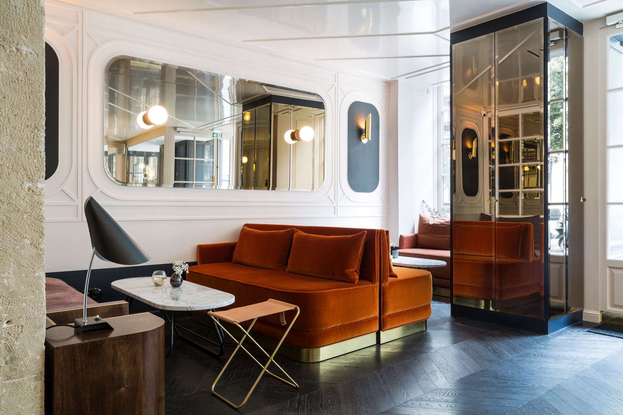 The in-house bistro, Restaurant Le Panache, has custom velvet-upholstered banquettes detailed with brass banding.
