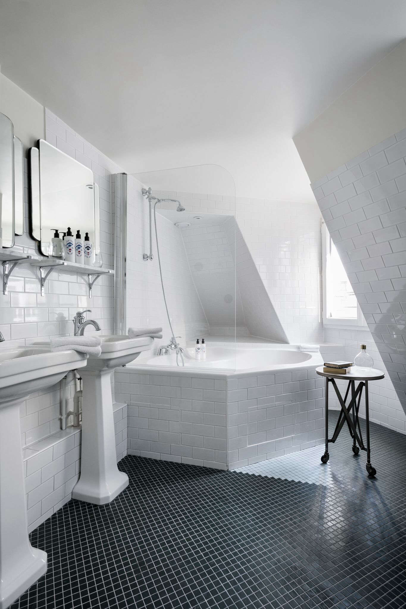 Tucked under the mansard roof on the top floor, a corner tub with a view.