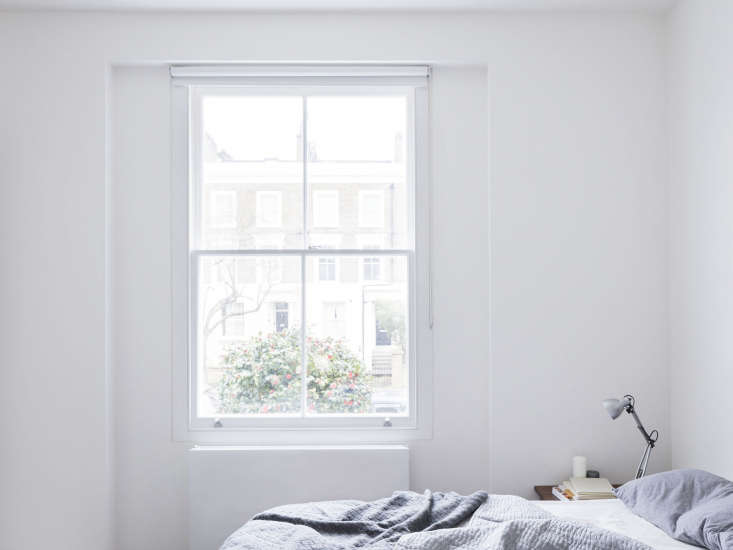 The master bedroom is airy and minimalist. The wall radiators throughout are the Hudevad P5from Denmark.