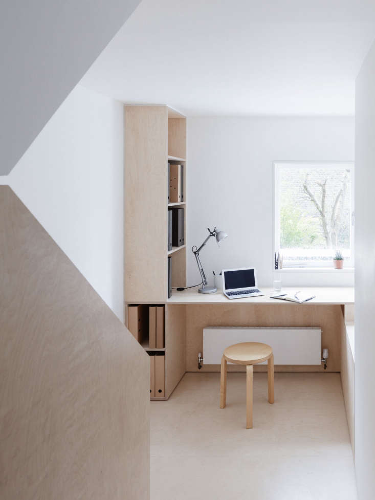 The study, which has its own integrated shelving, replaced an enclosed storage area. The window brings natural light into the stairwell.
