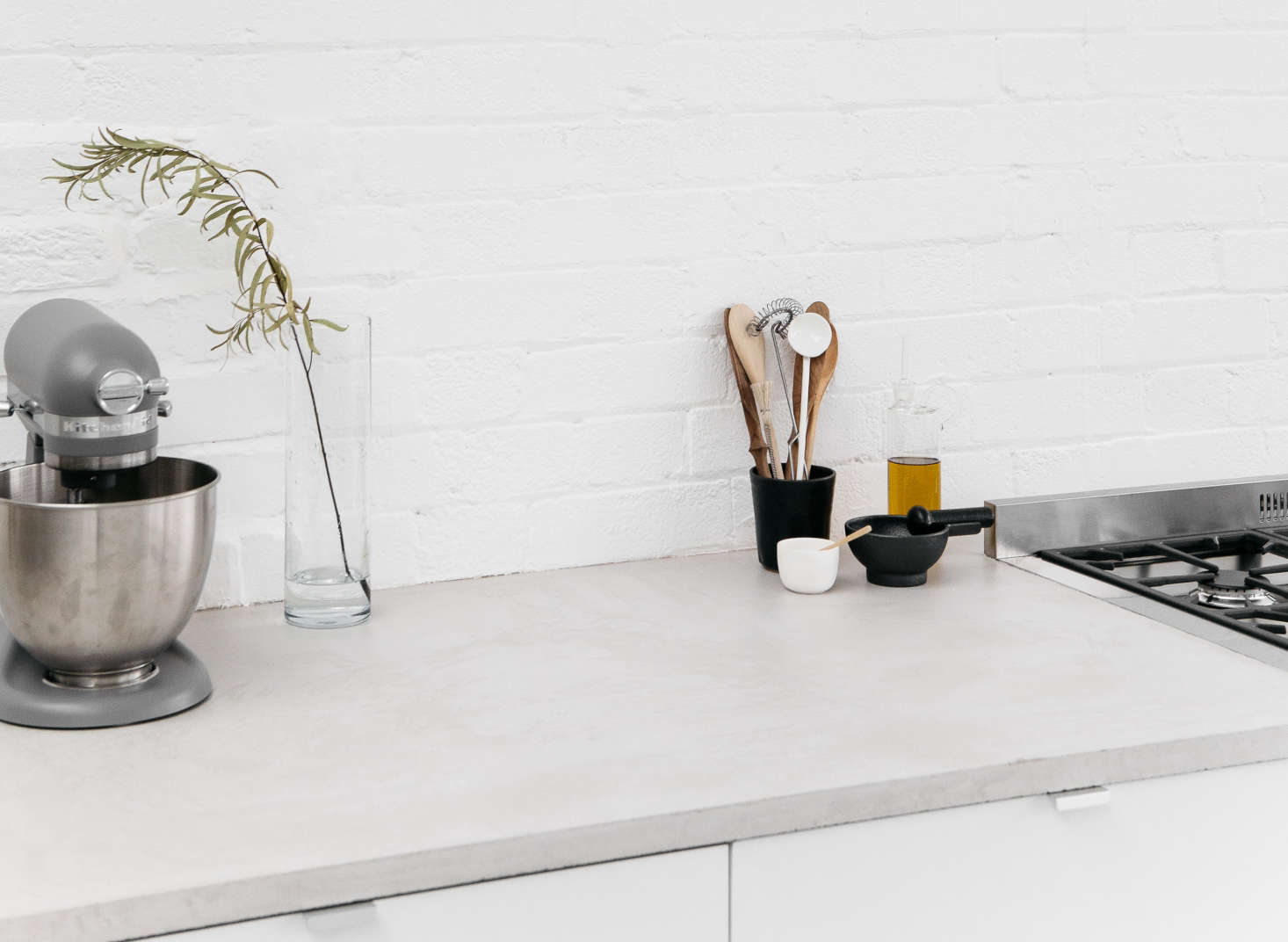 """A kitchen in a huge space in East London has hybrid concrete counters: marine-grade MDF plastered with a thin layer of micro-concrete. """"We wanted to use normal concrete, which is more water-resistant, but it's too heavy; micro-concrete isn't water-resistant,&#8"""