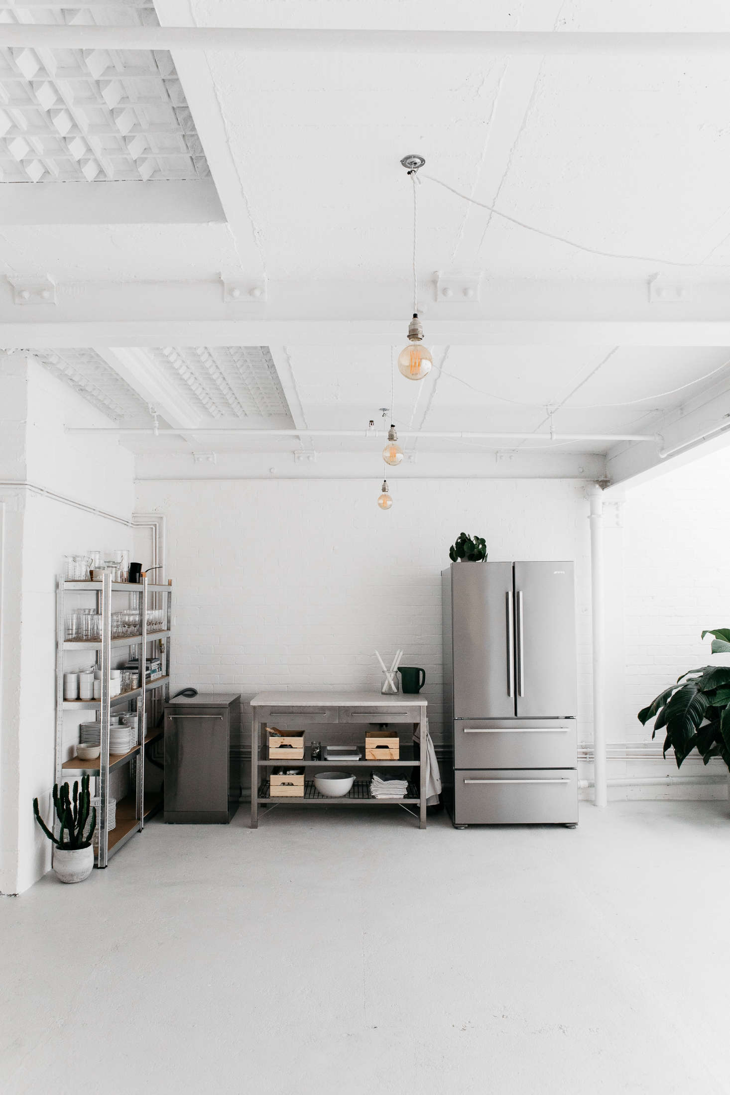 Half of the Rye kitchen in London is comprised of stainless steel workbenches and appliances. For more see Kitchen of the Week:An Artful Ikea Hack Kitchen by Two London Foodies.