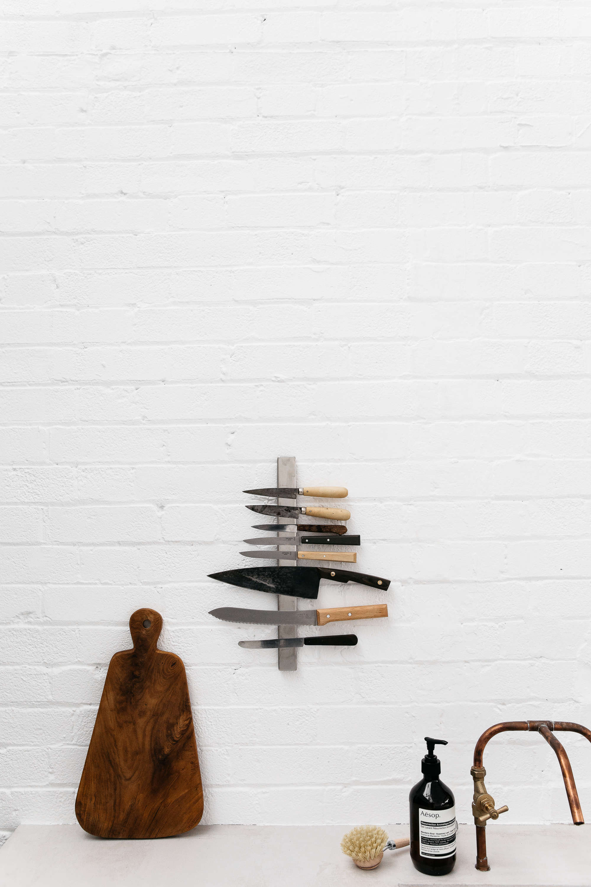 white painted brick wall, diy copper piping kitchen faucet, and vertical magnet 15