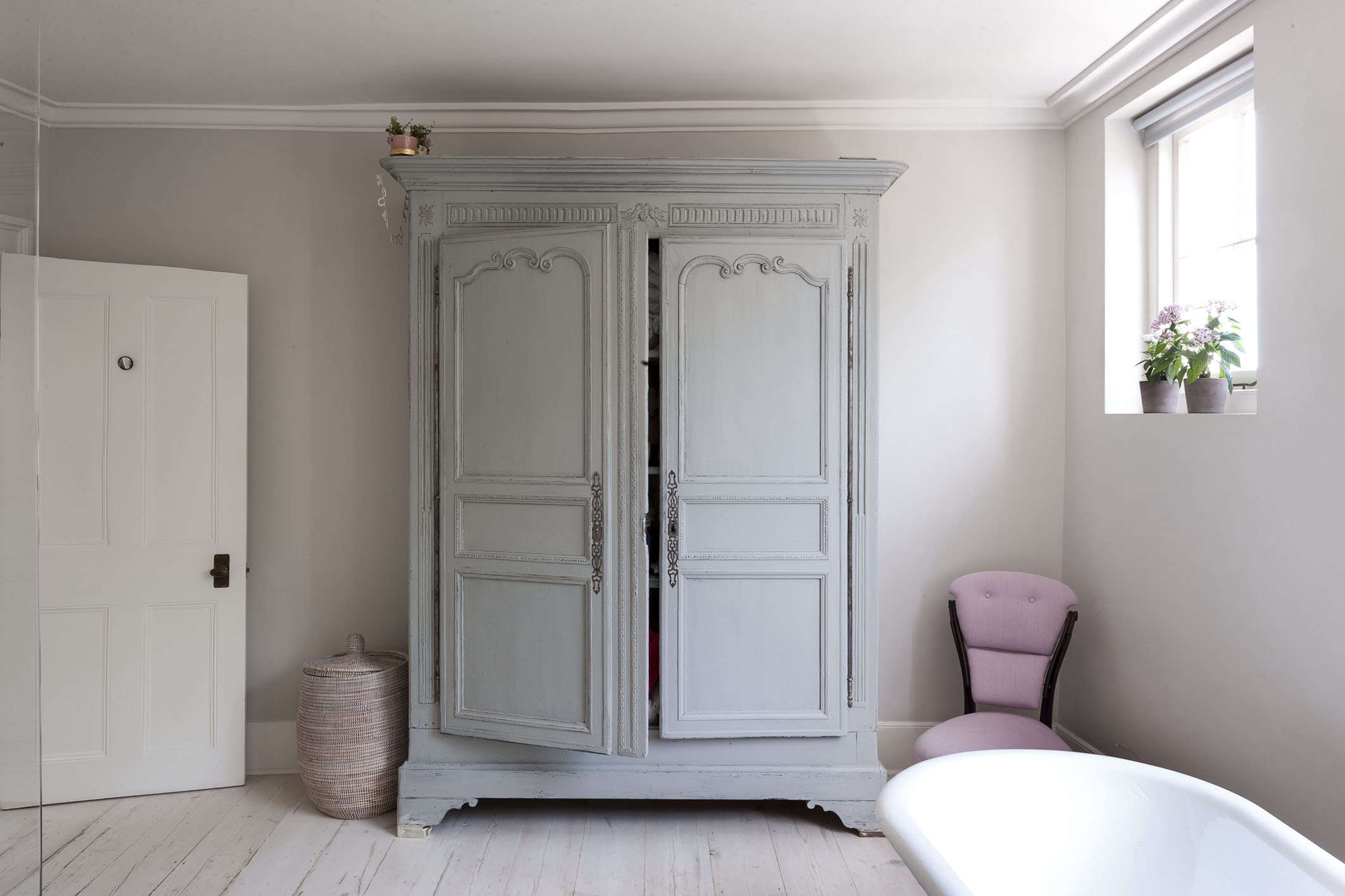 Bathroom of the Week A Romantic London Bath Made from Vintage Parts antiqued blue armoire michelle mckenna bath uk pink chair