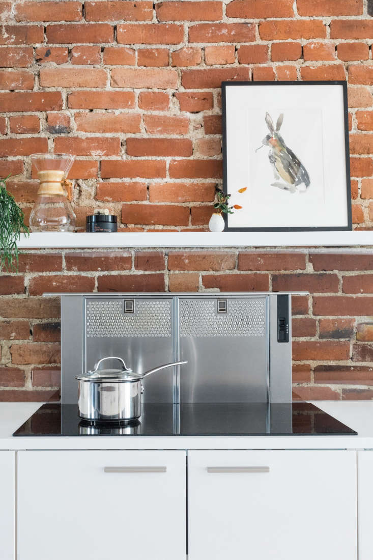 when not in use, the bosch downdraft range hoodretracts completely into the c 14