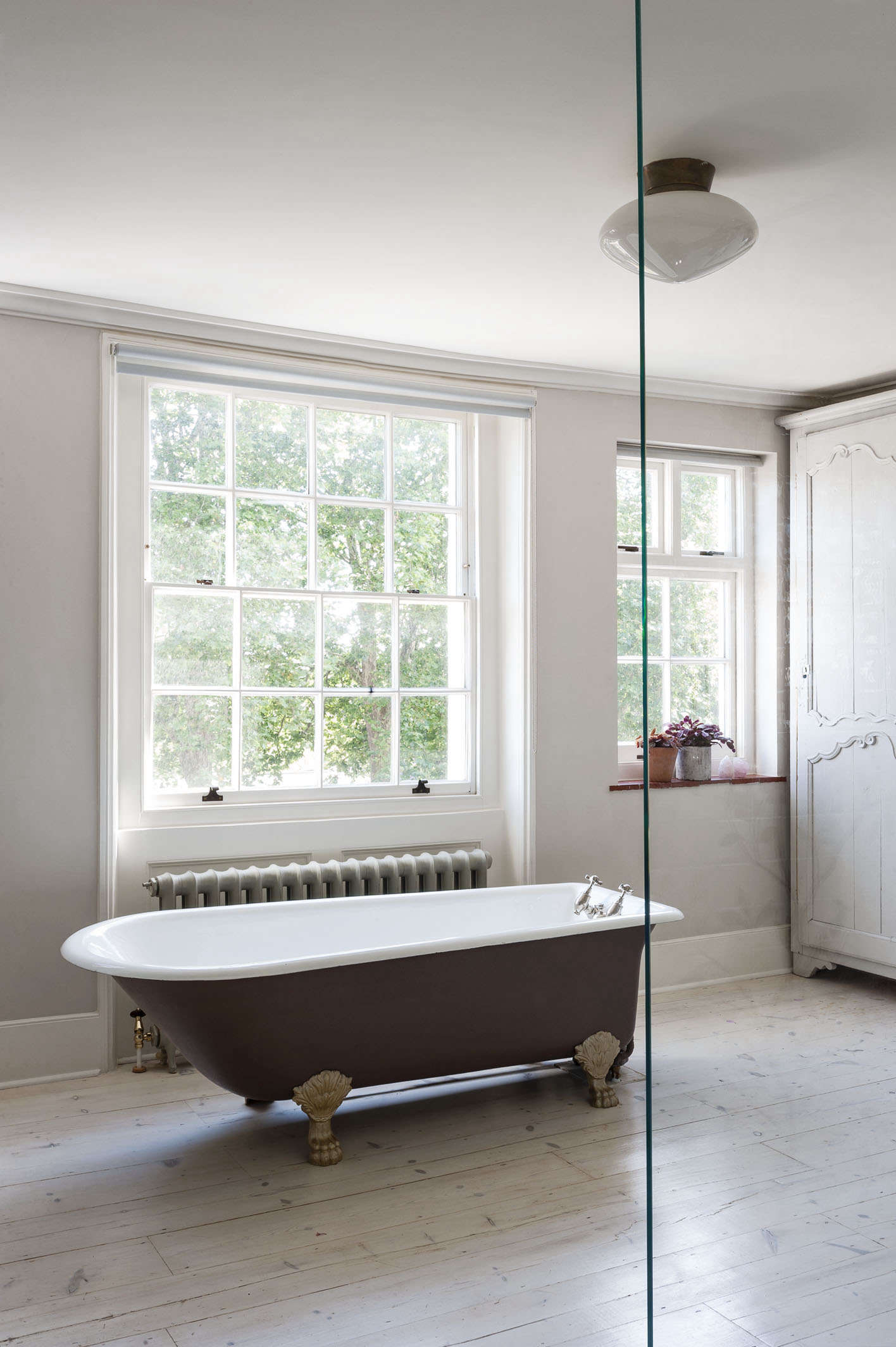 A claw-foot tub featured in Bathroom of the Week: A Romantic London Bath Made from Vintage Parts. Photograph by Matthew Williams for Remodelista.
