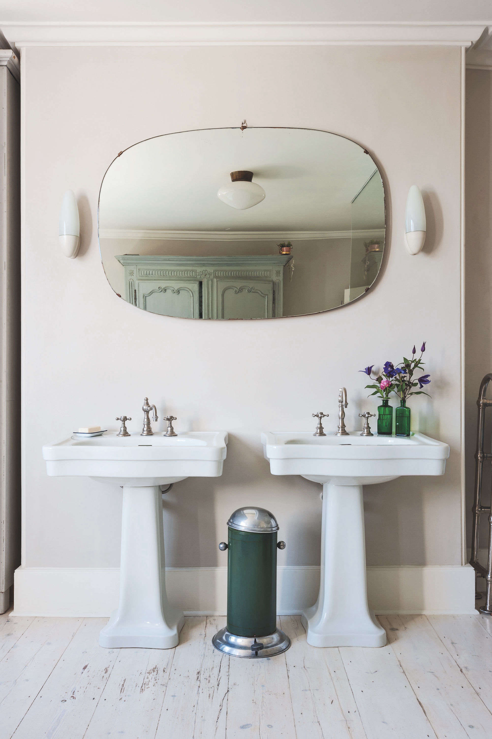 Bathroom of the Week A Romantic London Bath Made from Vintage Parts dual pedestal sinks green trash can round mirror bathroom uk