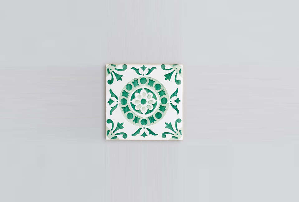 the alfama tile with round detailing at center. hand painting each piece before 14