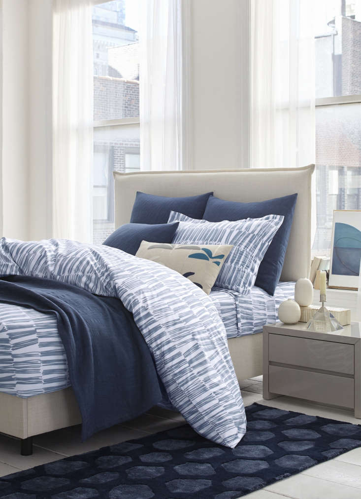the indigo bedding set is valued at up to \$8\20. it includes a brushstroke mat 12
