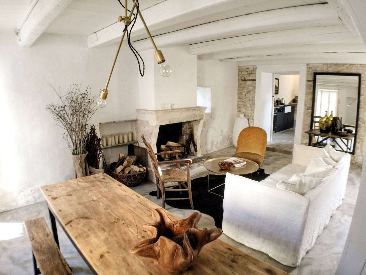 A farmhouse table and long bench, ready for relaxed French dinners. For ideas, see Steal This Look: Living Room at La Maison du Figuier in France.