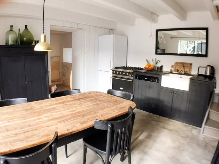 we love the rustic eat in kitchen at la maison du figuier, an airbnb on france& 18