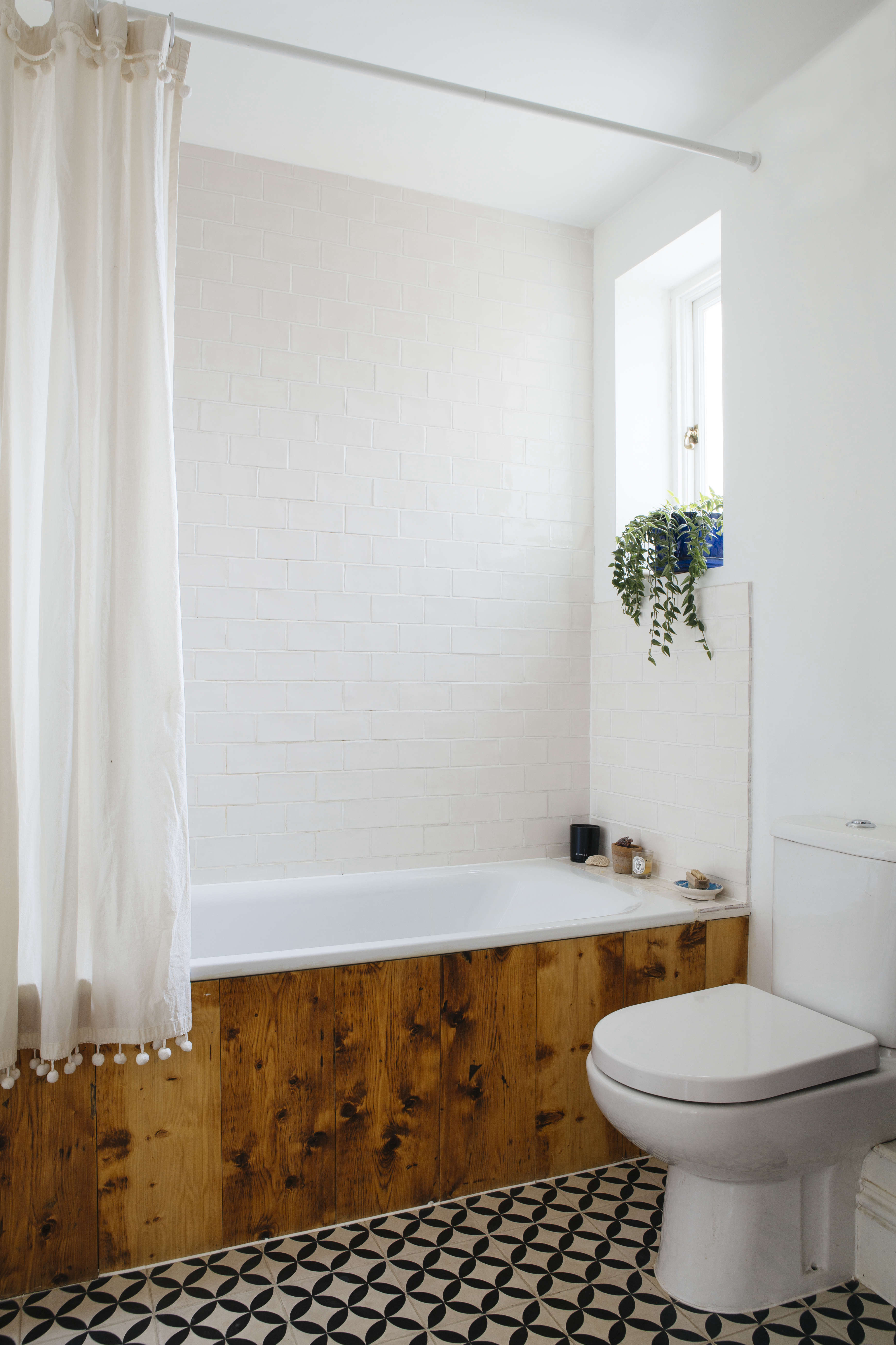 Ash moved a wall in the bathroom to create more space in the spare room and a built-in laundry cupboard in the hallway. The bath, where Ash carefully does all of her own indigo dying, has been paneled with the same reclaimed wood as the floor. (&#8