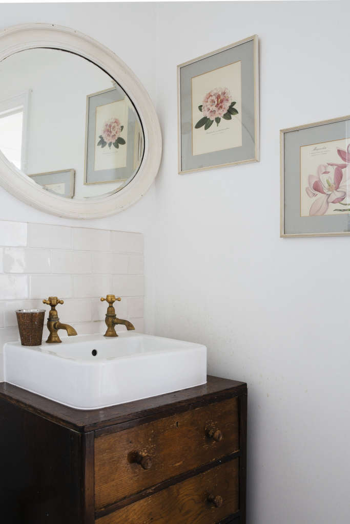 """ash mounted the bathroom sink on a vintage wooden cabinet. she says: """"i reall 19"""