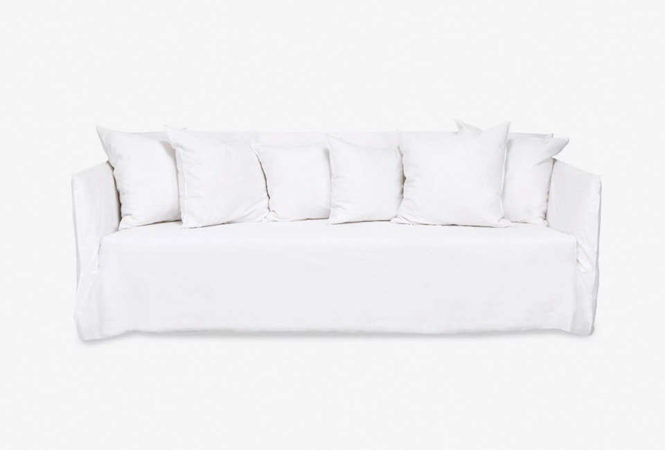 TheGhost Linen Sofa is by Italian designer Paola Navone for Gervasoni. For a similar look, see theElm Sofa from Cisco Brothers. For more, see our post  Easy Pieces: The Perfect White Sofa.