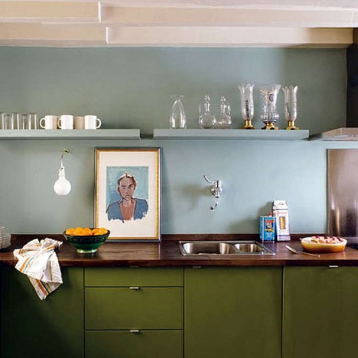 a two toned kitchen with a wood counter by paris designer and architect philipp 15