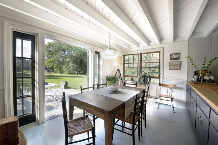 The kitchen and dining room can be opened to the backyard in warm weather.
