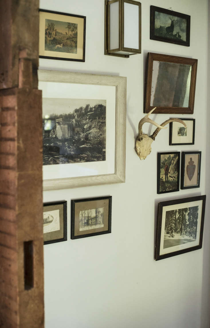 In the upstairs hall, finds from the house and from flea market are tied together by a neutral palette.
