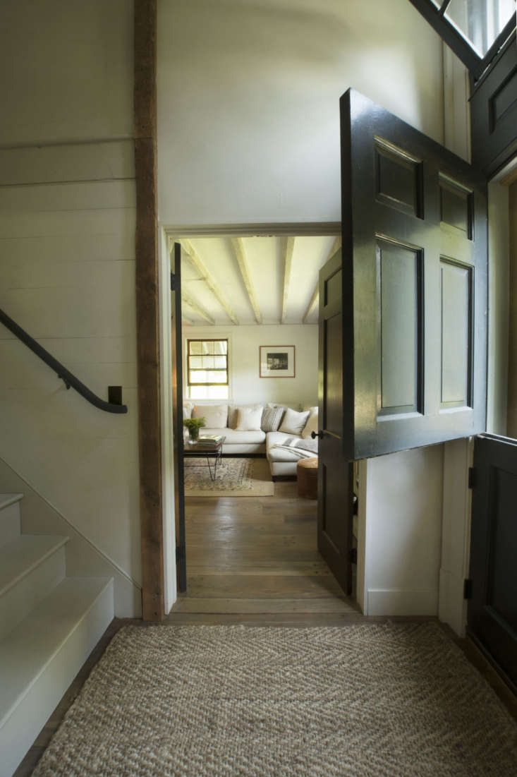 A salvaged Dutch front door leads into the entryway and stair.