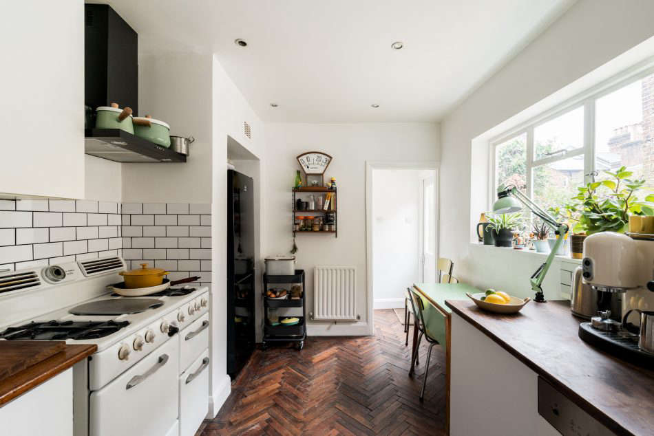 The pair found the vintage parquet flooring from a salvage yard in Kent. The blackrange hood is from Ikea.