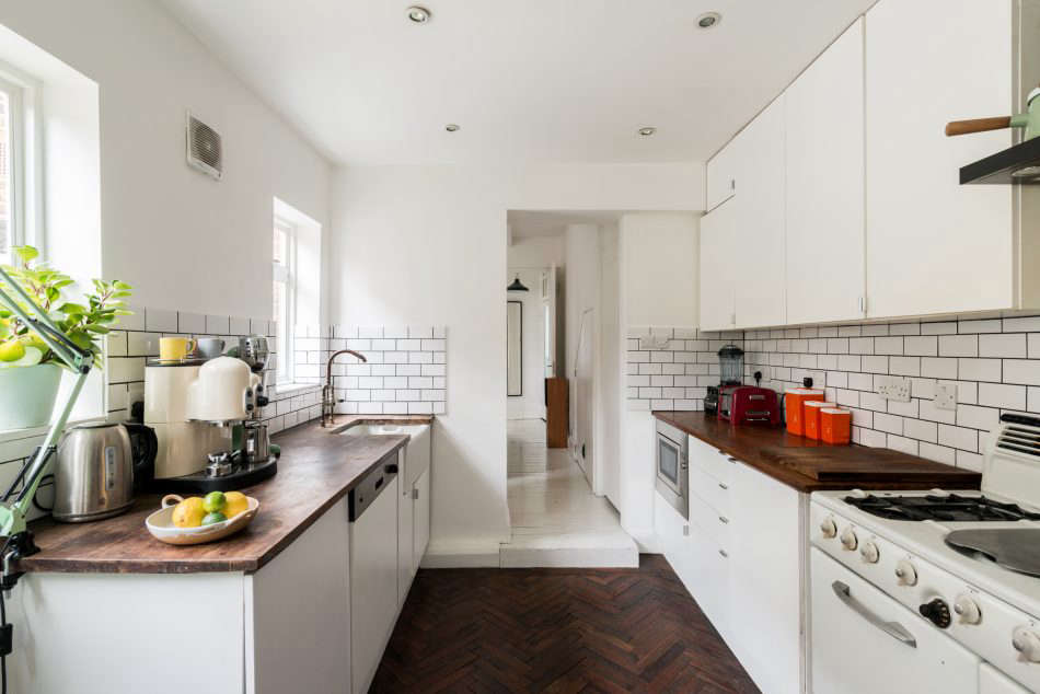 InKitchen of the Week: A Retro Kitchen in London from an Emerging Design Star, a dishwasher fits beneath African hardwood countertops.