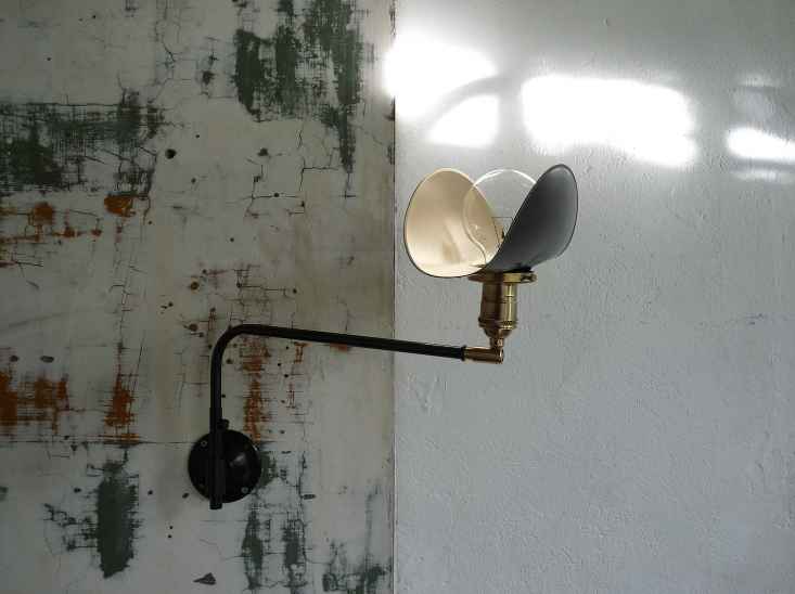 The petite MarianneSwing Wall Lamp has a brass switch socket; €4 ($45loading=