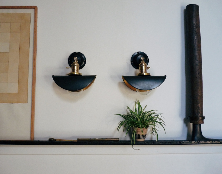 The Untel Sconce can swivel to any angle and is fully customizable with a variety of shades. Shown here: black patina bent steel; €0 ($5) each, €459 ($487) for the pair.