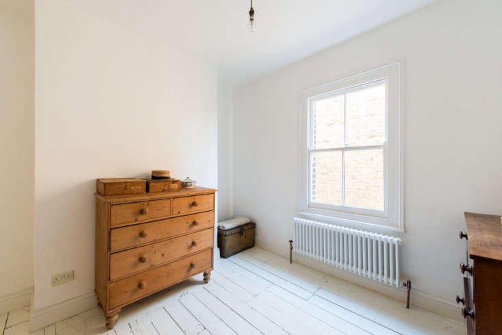a white painted wood floor, antique wood chests, and a restored vintage radia 19