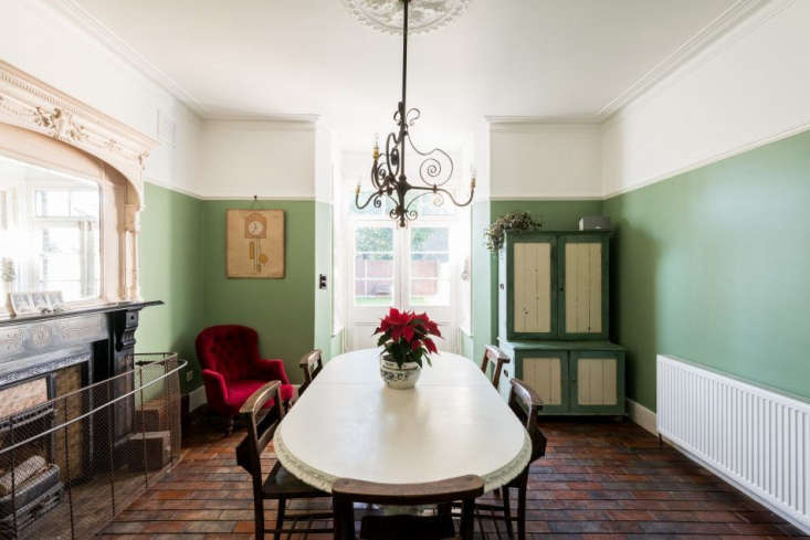 the dining room—in farrow & ball breakfast room green—has an intricate  11