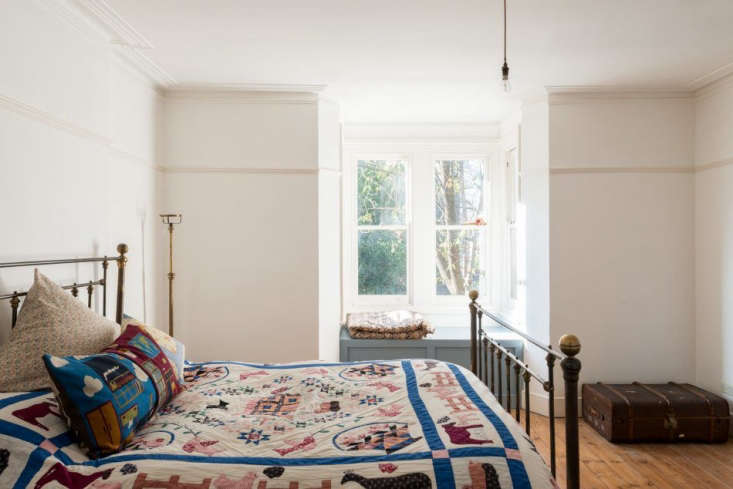 the master bedroom features an iron and brass bedstead that chinneck found on 18