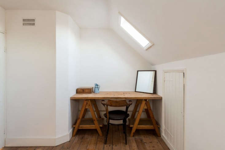 A small sawhorse table can also tuck away and be used as a desk, as seen Sculptor Alex Chinneck's Renovated Family Home In London. Photograph via The Modern House.