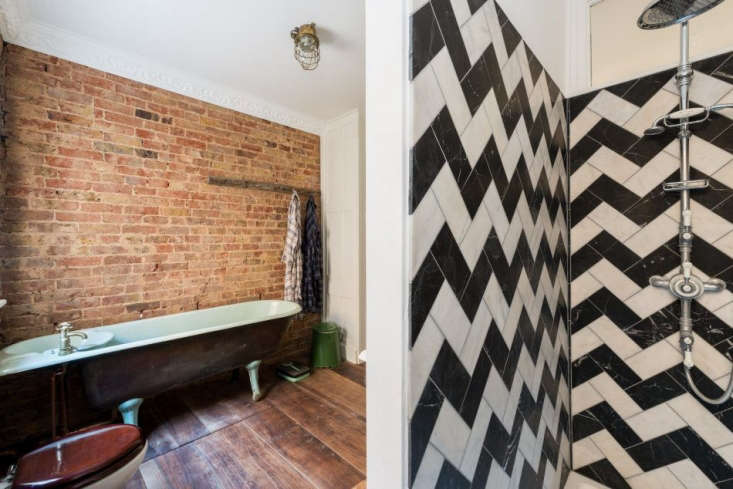 the sink is cast into the bath. a zigzag of black and white marble tiles patter 23