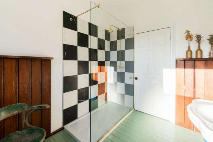 the room has an unexpected glass walled shower that shows off a checkerboard  27