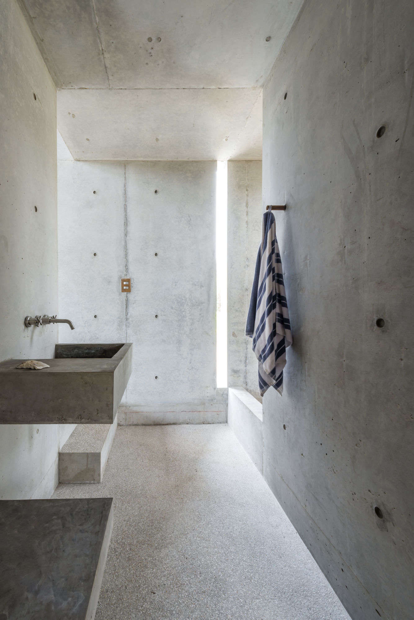 Concrete sink as sculpture: the sink in the bathroom of Casa Tiny in Oaxaca.