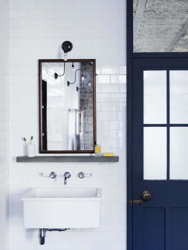 the bathroom, like the pantry, is lined inmetro white subway tile, which, lew 19