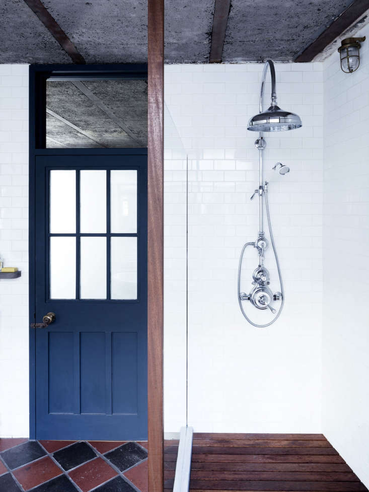 the shower has a wood trimmed glass wall, a waterproof wood floor, and a show 21